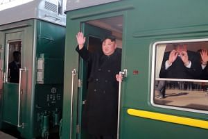 North Korean leader Kim Jong Un waving as he boards a train in Pyongyang that is bound for Hanoi, on Feb 23, 2019.