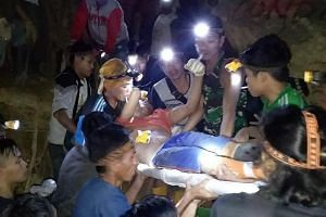 Rescuers carrying out a survivor from the collapsed mine in the Bolaang Mongondow region of North Sulawesi on Feb 27. One person had been found dead and 13 people rescued by 5am on Feb 27 after the collapse the previous evening.