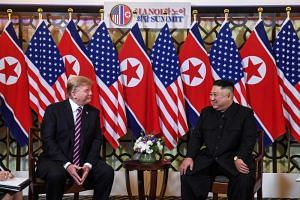 US President Donald Trump and North Korean leader Kim Jong Un posed for photos before they started their meeting on Feb 27, 2019.
