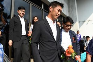 Future Forward Party leader Thanathorn Juangroongruangkit (centre) arriving at the Office of the Attorney General in Bangkok on Feb 27, 2019.