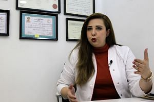 Iraqi family physician Shaymaa al-Kamali said relatives of a patient had stormed her clinic after she barred the patient's father from staying in the hospital after visiting hours. She had to flee through a service entrance.