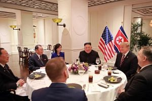 North Korean leader Kim Jong Un and US President Donald Trump sat down for dinner with aides following a one-on-one meeting in Hanoi on Feb 27, 2019.