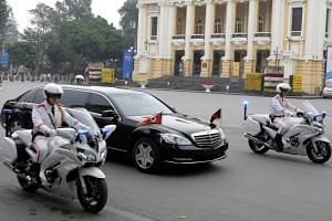 North Korean leader Kim Jong Un's motorcade travels past the Hanoi Opera House after a meeting with US President Donald Trump in Hanoi on Feb 28, 2019.