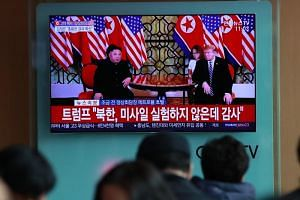 South Koreans watch the live television coverage of the second summit between US President Donald Trump and North Korean leader Kim Jong Un in Seoul on Feb 28, 2019.