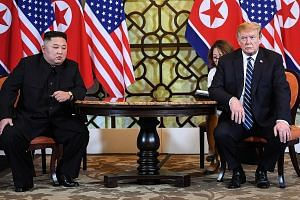 "North Korean leader Kim Jong Un and US President Donald Trump at the Sofitel Legend Metropole Hanoi hotel yesterday. Mr Trump said Pyongyang was willing to denuclearise, ""but in areas lesser than what we want""."