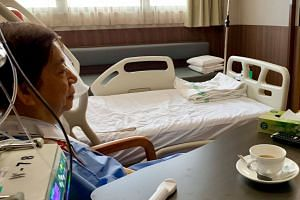 Transport Minister Khaw Boon Wan shared a photo of him in hospital with a cup of coffee next to him after his surgery.