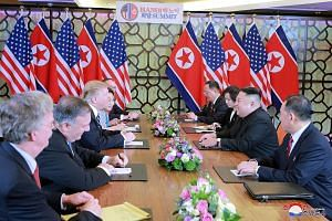 North Korean leader Kim Jong Un and US President Donald Trump and their respective delegations during their second summit in Hanoi, in a photo released yesterday by North Korea's Korean Central News Agency. The two-day summit ended early without a de