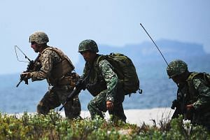 Philippine and US soldiers taking part in an annual joint military exercise in San Antonio in the Philippines' Zambales province last May. Regular war games are held between the two countries under their Mutual Defence Treaty.
