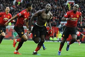 Manchester United's Romelu Lukaku (centre) celebrates after scoring his second goal.