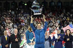 Federer celebrates with the trophy after winning the final against Greece's Stefanos Tsitsipas.