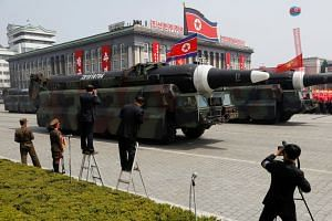 Missiles are driven past Kim Il Sung Square in Pyongyang during a military parade, on April 15, 2017.