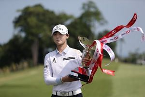 Park Sung-hyun posing with the trophy after winning the HSBC Women's World Championship on March 3, 2019.