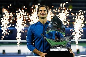 Roger Federer with his trophy after defeating Stefanos Tsitsipas of Greece in the final at the Dubai Championships on Saturday.