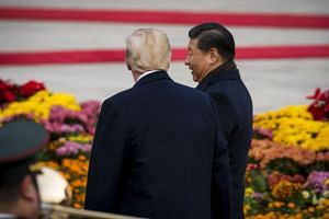US President Donald Trump (left) and China's President Xi Jinping leaving a business leaders event at the Great Hall of the People in Beijing on Nov 9, 2017.