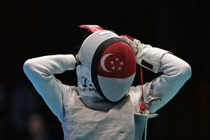 Singapore's Amita Berthier putting on her mask in the women's foil team quarterfinal against Chinese Taipei at the 18th Asian Games on Aug 23, 2018.