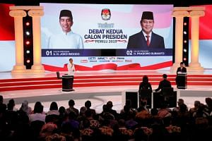 President Joko Widodo speaks during a debate with his opponent Prabowo Subianto in Jakarta, on Feb 17, 2019. Most polls have put Mr Joko at an electability rate of around 53 to 60 per cent, while Mr Prabowo has languished in the mid-30s.