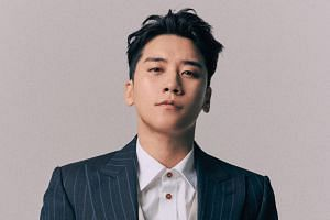 Seungri (above) had been questioned for more than eight hours over allegations of drug use and provision of sexual services to VIP customers in his Burning Sun club.