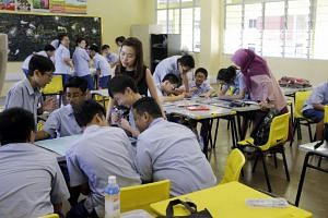 Students at Ping Yi Secondary School. Streaming was introduced from the 1980s to arrest the high school attrition rate, said Education Minister Ong Ye Kung.