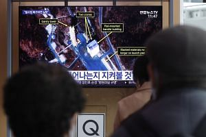 People watch a TV broadcast at Seoul Station in Seoul, South Korea, on March 7, 2019.