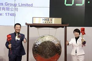 Mr Zhang Yong and his wife, Ms Shu Ping, preparing to strike a gong during Haidilao's listing ceremony in Hong Kong last September. The Chinese hotpot restaurant chain was founded in 1994 and now has about 370 outlets in China, and some 30 branches o