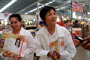 Party members of the Pandin Dharma Party talk to supporters during their campaign rally in Bangkok, on Feb 25, 2019.