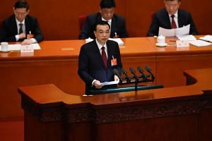 Chinese Premier Li Keqiang delivers his work report during the opening session of the National People's Congress at the Great Hall of the People in Beijing on March 5, 2019.