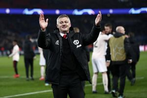 Manchester United caretaker manager Ole Gunnar Solskjaer (centre) celebrates after the final whistle of the Uefa Champions League where Manchester United beat Paris Saint-Germain at the Parc des Princes stadium on March 6, 2019.