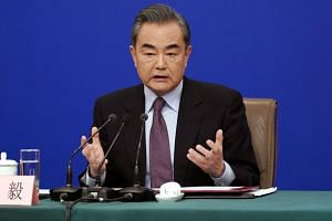 State Councillor Wang Yi speaks during a press conference on the sidelines of China's National People's Congress in Beijing, China on March 8, 2019.