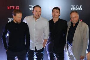 (From left) Triple Frontier stars Charlie Hunnam, Ben Affleck and Garrett Hedlund, along with producer Chuck Roven, greet the city's biggest fans at the Digital Light Canvas at The Shoppes at Marina Bay Sands on March 8, 2019.