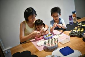 Ms Christine Koh with her kids Hui Yu Tong, 4 and Hui Cheng Jun, 7, making egg muffins.