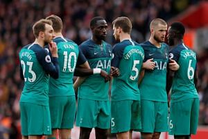 Tottenham's Moussa Sissoko, Eric Dier and team mates form a wall to defend a free kick.