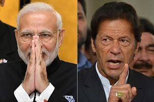 Indian Prime Minister Narendra Modi (left) roused his countrymen at rallies while his Pakistani counterpart Imran Khan's peace gesture over the Indian pilot has won praise at home.