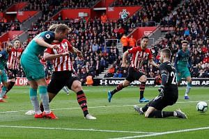 Tottenham and England man Harry Kane scoring his 200th goal for club and country with a 26th-minute opener at Southampton yesterday. But it was not enough for third-placed Spurs to avoid defeat at manager Mauricio Pochettino's old club and end their