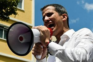 Venezuelan opposition leader and self-proclaimed acting president Juan Guaido speaks during a demonstration in Caracas, on March 9, 2019.