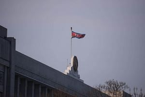 A North Korean flag flies above the Supreme People's Assembly in Pyongyang, on March 9, 2019.
