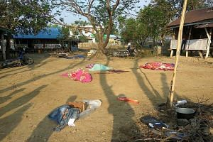 The covered bodies of policemen killed in a militant attack on Saturday at Yoetayoke village, near Rakhine state's capital Sittwe.