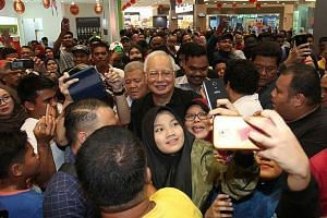 Former prime minister Najib Razak being mobbed at a Selangor hypermarket. Apart from attracting crowds, he has been an active government critic on social media.