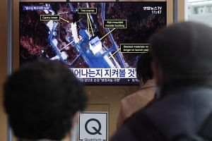 People watch a television broadcast on North Korea's Sohae rocket-testing facility, at Seoul Station in Seoul, South Korea, on March 7, 2019.