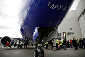 Boeing employees stand in front of a 737 MAX 8 produced for Southwest Airlines as Boeing celebrates the 10,000th 737 to come off the production line in Washington, US, on March 13, 2018.
