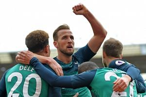 Harry Kane (centre) celebrates scoring against Southampton.