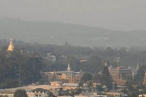 A view from the Mae Sai District Health Office on Monday (March 12) shows the city in Chiang Rai enveloped in haze, with the day's PM2.5 particulate level peaking at 128mcg, well beyond the Thai safety limit of 50mcg.