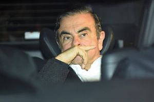 Former Nissan chairman Carlos Ghosn leaveing his lawyers' offices after he was released from a detention centre in Tokyo, on March 6, 2019.