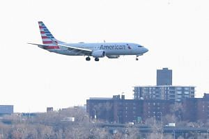An American Airlines Boeing 737 Max 8, on a flight from Miami to New York City, comes in for landing at LaGuardia Airport, on March 12, 2019.