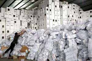 A worker sorts ballot papers for the upcoming general elections at a warehouse in Bogor, Indonesia, on Feb 27, 2019.