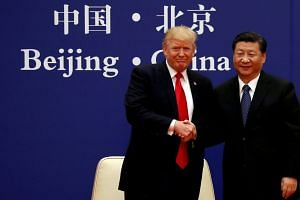 Donald Trump and Xi Jinping meet business leaders in Beijing, China, in 2017.