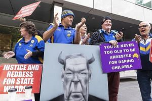 Protesters outside the County Court of Victoria in Australia yesterday after George Pell, 77, was sentenced to six years in jail for sexually abusing two choir boys in Melbourne in the 1990s. Pell, who will be registered as a sex offender for the res