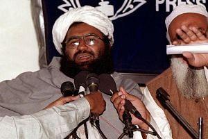 Masood Azhar (left), chief of the Jaish-e-Mohammad (JeM), addresses a press conference in Karachi, on Feb 4, 2000.