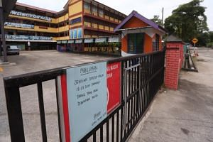 SK Taman Rinting 2 primary school, a 20-minute drive from Pasir Gudang, has been closed since March 13, 2019. A sign in Malay on the gate says that it is not certain when school will re-open.