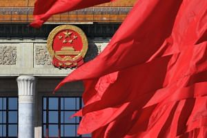 Red flags flutter outside the Great Hall of the People during the closing session of a conference in Beijing, China, on March 13, 2019.
