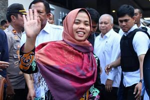 Malaysian Siti Aisyah was freed from custody without acquittal and allowed to return home a day before South Korean President Moon Jae In arrived in Kuala Lumpur for a three-day state visit.